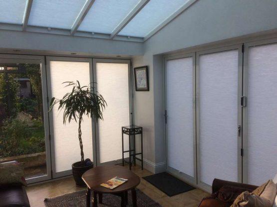 aluminium conservatory with aluminium bifolds